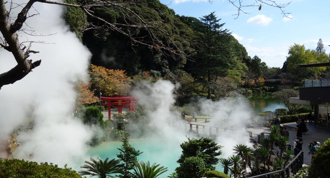 The blue color of the pond is due to the dissolution of iron sulfate, a component in the hot spring.